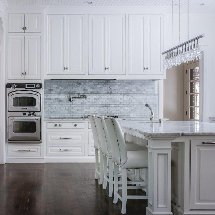 Ceiling height white kitchen cabinets iowa remodels for Ceiling height kitchen cabinets