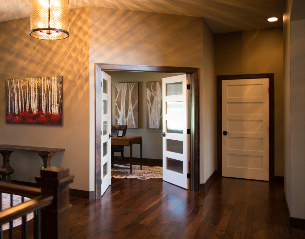 Dark poplar baseboard trim with white doors iowa remodels for Combining stained and painted trim