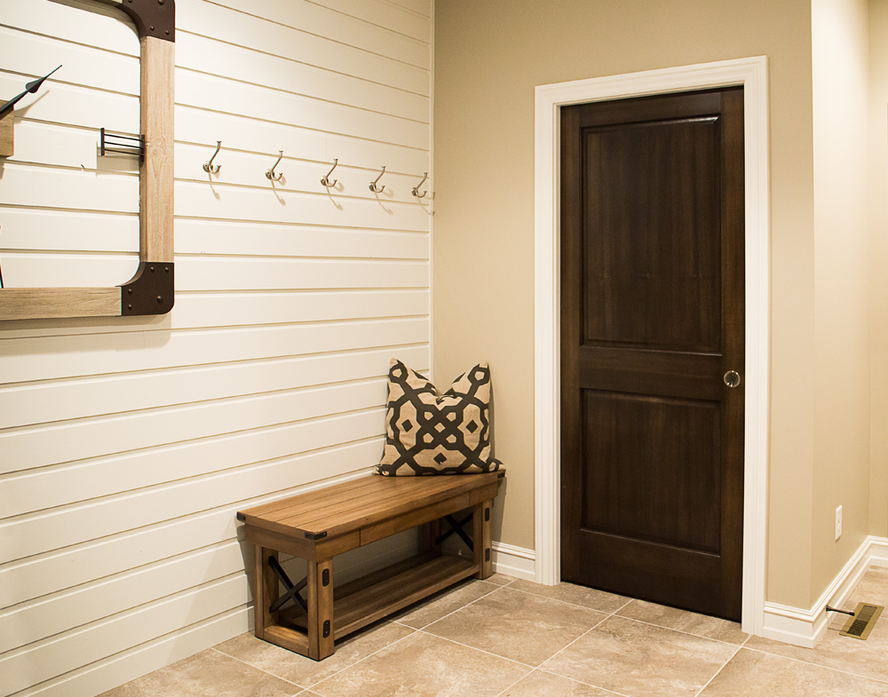 White baseboard trim with dark wood door iowa remodels for Wood doors with white trim pictures